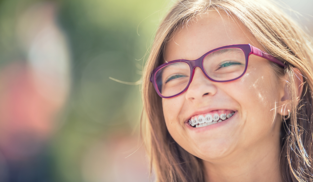 girl with purple glasses smiling