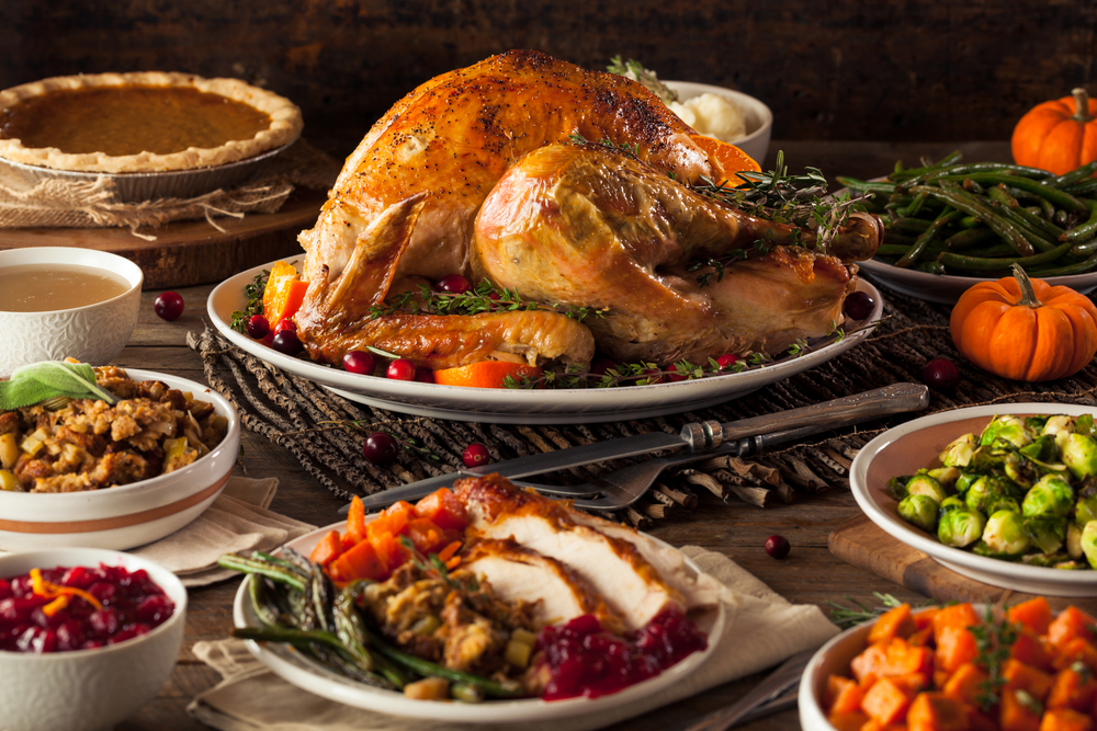 A holiday dinner with turkey, green beans, pumpkin pie, and more.